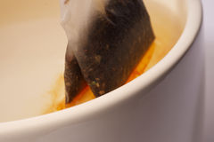 Tea bag in a cup Royalty Free Stock Photos