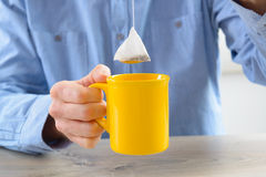 Tea bag and cup royalty free stock image