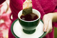Tea bag with a cup of tea Royalty Free Stock Image