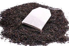 Tea bag and dried tea leaves Stock Photo