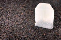 Tea bag and dried tea leaves Royalty Free Stock Photos