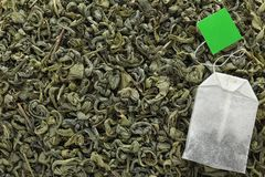 Tea bag on dry leaves, top view. With space for text stock photography