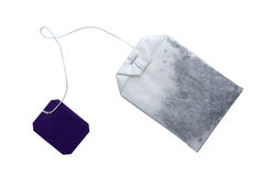 Tea bag with empty tag. Tea bag with violet tag isolated on white. Clipping path included Stock Photo