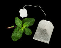 Tea bag and fresh mint Stock Photography