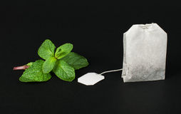 Tea bag and fresh mint Stock Photos