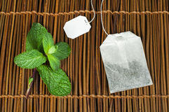 Tea bag and fresh mint Royalty Free Stock Images