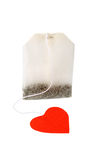 Tea bag with heart-shaped red label isolated royalty free stock photography