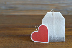 Tea bag with heart-shaped tag Royalty Free Stock Image