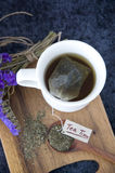 Tea bag in hot tea cup Royalty Free Stock Photo