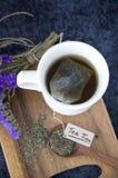 Tea bag in hot tea cup Royalty Free Stock Photo
