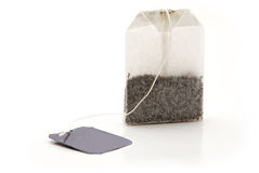 Tea bag with a label. On a white background Stock Photo