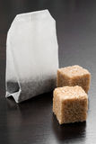 Tea bag with lumps of sugar Stock Images