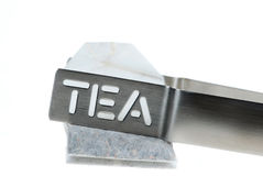 Tea bag and Metal Tongs Stock Photography