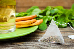 Tea bag? mint, cookie and cup of tea Stock Image