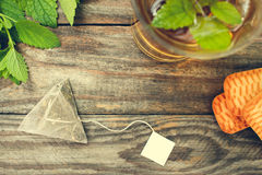 Tea bag, mint, cookie and cup of tea. Toned image. Top view Royalty Free Stock Photo
