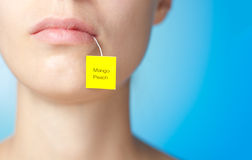 Tea bag in mouth of woman Stock Photography