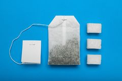 Tea bag with sugar isolated on blue background.  royalty free stock photo