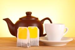 Tea bag and teapot Stock Photography