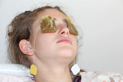 Tea bag for tired eyes. Tea bag therapy for tired eyes royalty free stock photo