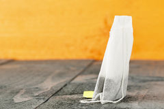 Tea bag on wooden background Royalty Free Stock Image