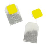 Tea bag with yellow label without inscription Royalty Free Stock Images
