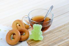 Tea bagels and marmalades. Glass Cup tea with bagels and marmalades Breakfast on a wooden table Stock Photos