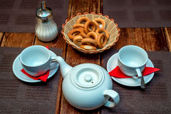 Tea with bagels Russian tradition. Close up teapot with two cups of tea and bagels Stock Photos