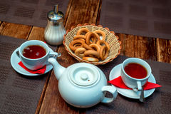 Tea with bagels Russian tradition. Close up teapot with two cups of tea and bagels Royalty Free Stock Photos