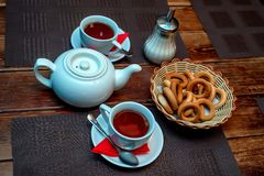 Tea with bagels Russian tradition. Close up teapot with two cups of tea and bagels Royalty Free Stock Images