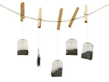 Tea bags. At the peg against white background Stock Images
