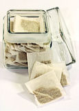 Tea bags in jar Royalty Free Stock Images