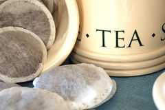 Tea Bags. This photo shows a close-up of some tea bags and caddy stock image