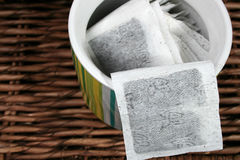 Tea Bags. In a green striped ceramic container Royalty Free Stock Photos