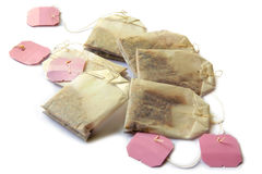 Tea bags. Six tea bags with blank pink labels on white background stock image