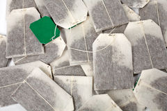 Tea bags background. Some tea bags with green label. Background horizontal stock images