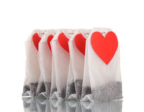 Tea bags with blank heart-shaped labels. Over the white stock image