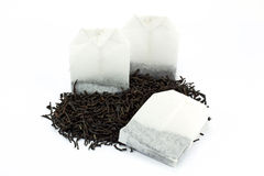 Tea bags and dried tea leaves. On white Stock Image