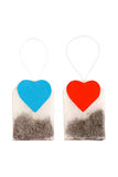 Tea bags with heart-shaped labels Stock Photos