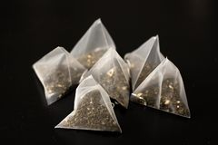 The tea bags isolated on black. / royalty free stock photo
