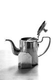 Tea bags and kettlle. Beautiful shot of tea bags with kettle Stock Photography