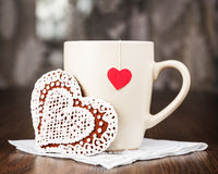 Tea bags with labels heart-shaped biscuits in the form of heart Royalty Free Stock Photography
