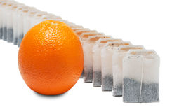 Tea bags and orange Stock Photo