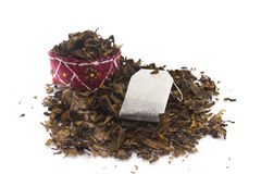 Tea Bags Over Dried Tea Leaves Background Stock Image