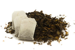 Tea Bags Over Dried Tea Leaves Background Royalty Free Stock Photos