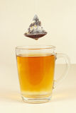 Tea bags over glass with freshly brewed tea Royalty Free Stock Image