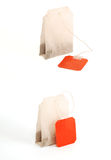Tea bags on white background. Tea bags with red lebel on white background Stock Images