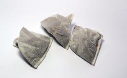 Tea bags on a white background. Three new tea bags on a white background Stock Photography