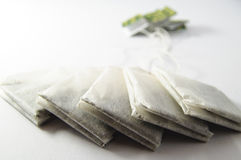 Tea bags on white surface Stock Photography