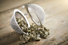 Tea ball with china gun powder tea Royalty Free Stock Photo