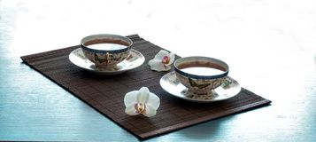 Tea on bamboo Royalty Free Stock Images